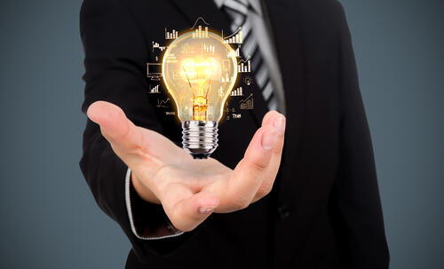 businessman-with-light-bulb-in-his-hand