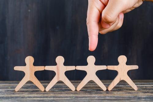 marketing-customer-analysis-concept-wooden-grunge-background-side-view-finger-targeting-wooden-man