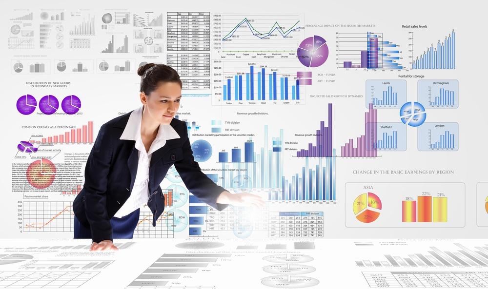Young businesswoman analyzing data information of market.jpeg